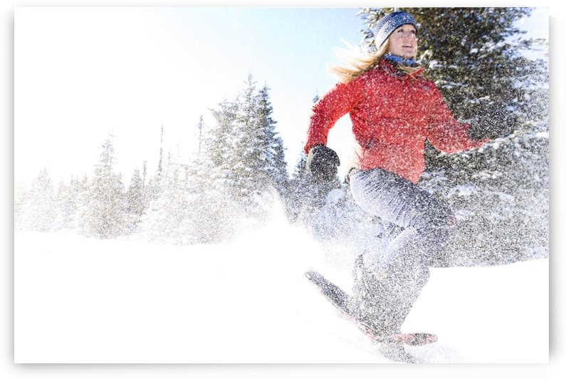 Young Woman On Snowshoes Enjoy The Outdoors Near Homer, Alaska During Winter. by PacificStock