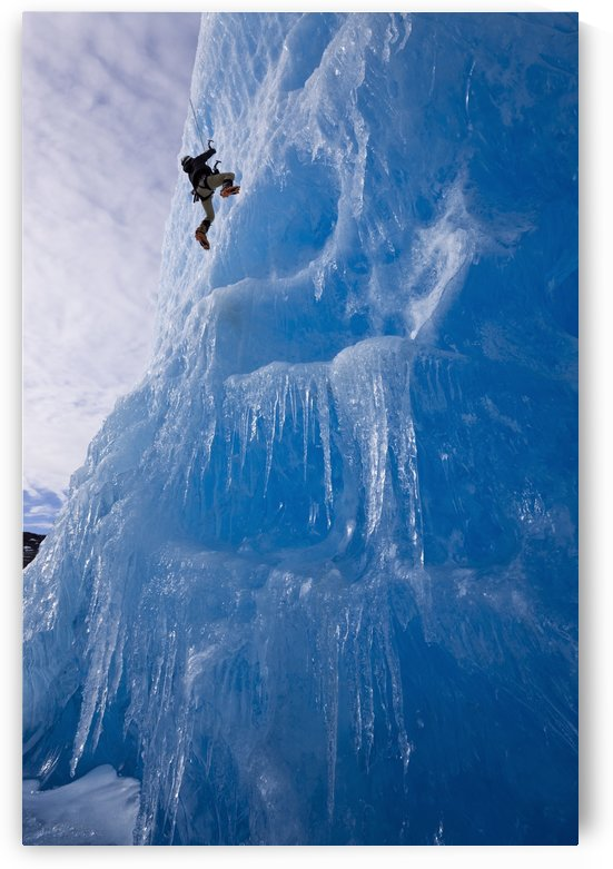 An Ice Climber Ascends The Face Of A Large Iceberg Frozen Into Mendenhall Lake, Juneau, Southeast Alaska, Winter by PacificStock