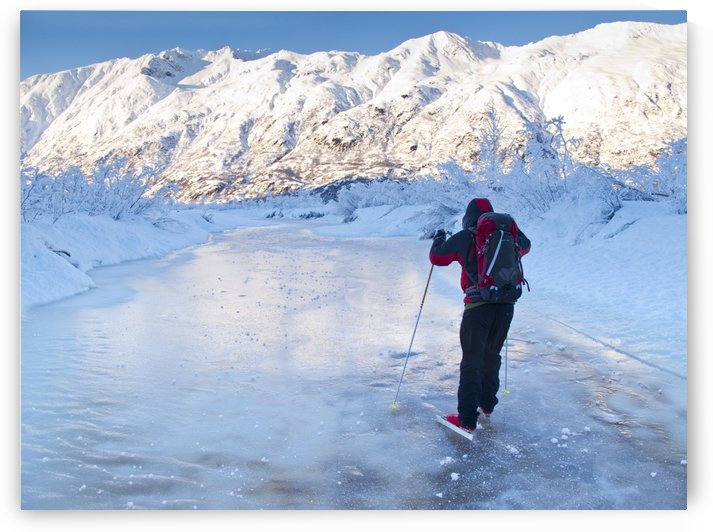 Man Nordic Ice Skating On The Frozen Placer River, Kenai Mountains, Southcentral Alaska, Winter by PacificStock