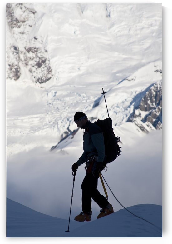 Climber Silhouetted On The Summit Of Control Tower With Glacier Icefall And Crevasses On Mount Foraker In The Background, Kahiltna Glacier, Alaska Range, Interior Alaska, Summer by PacificStock