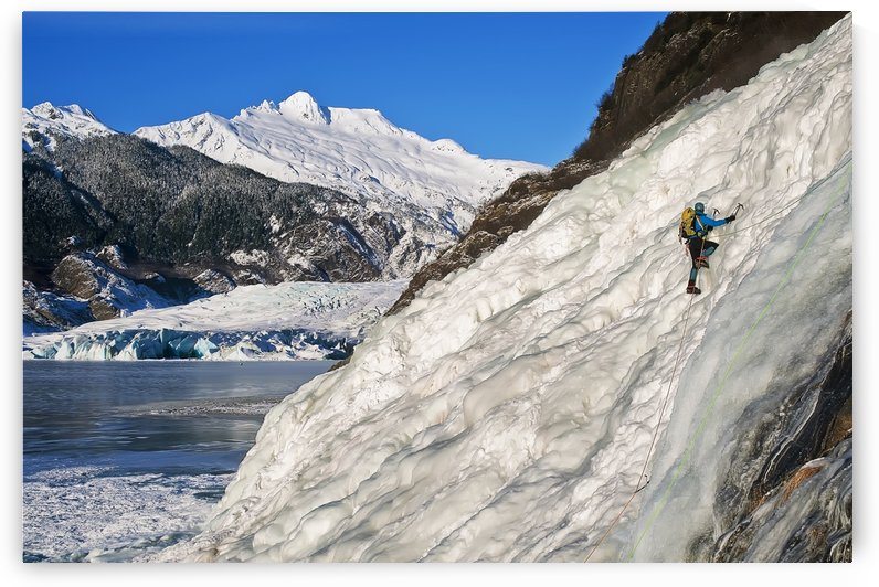 Female Ice Climber Climbs The Frozen Nugget Falls With Mendenhall Glacier In The Background, Juneau, Southeast Alaska, Winter by PacificStock