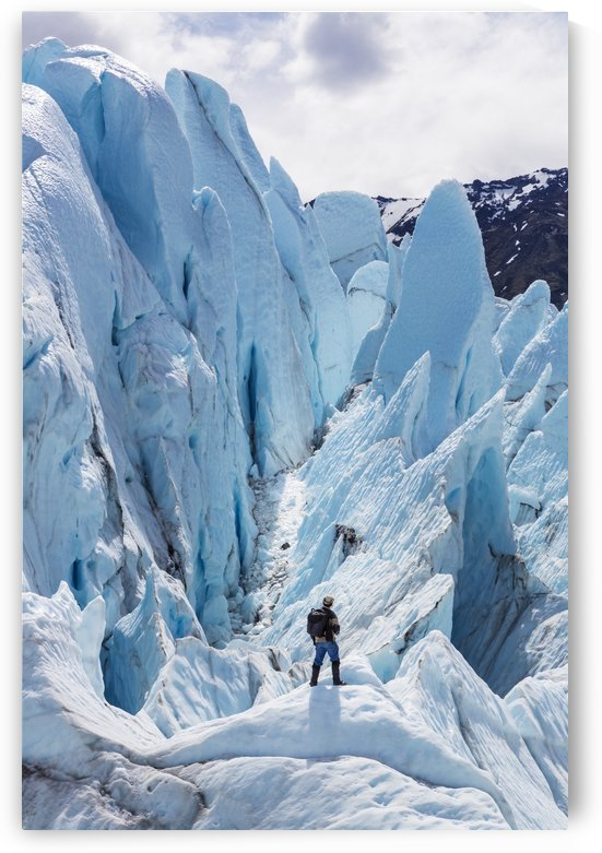Hiker standing on at the base of Matanuska Glacier, Southcentral Alaska, Summer by PacificStock
