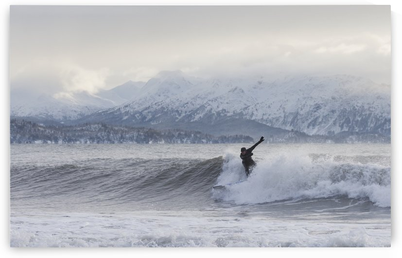 Person surfing in winter in Homer, Kenai Peninsula, Kachemak Bay, Alaska. by PacificStock
