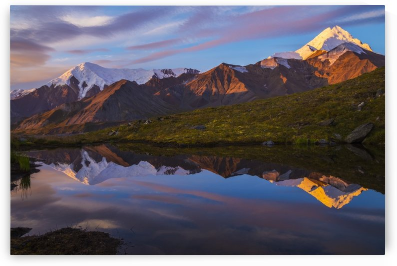 Mount Hayes reflects in a pond at sunrise, viewed from a remote area near the Hayes Glacier in the Alaska Range; Alaska, United States of America by PacificStock