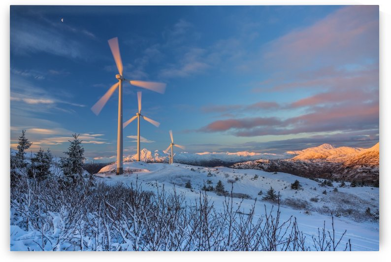Wind turbines and gibbous moon at sunrise, winter, Pillar Mountain; Kodiak, Alaska, United States of America by PacificStock
