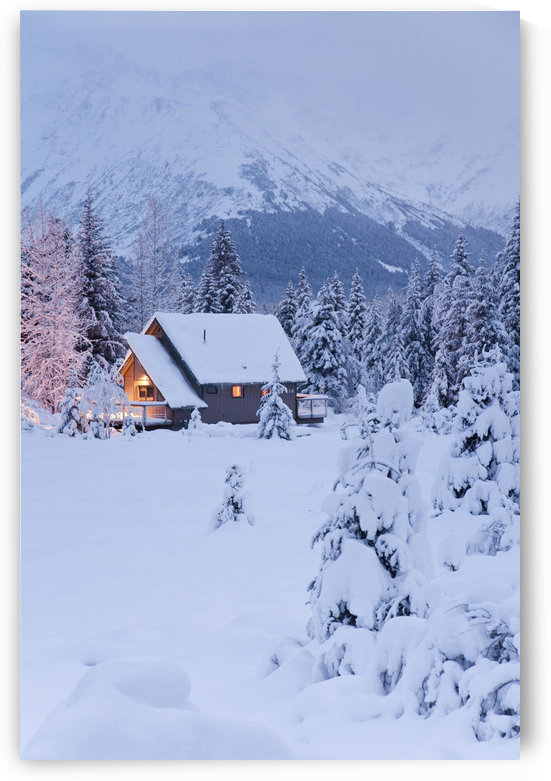 Snowcovered Home In A Wintry Meadow At Dawn With Inside Lights On, Girdwood, Southcentral Alaska by PacificStock