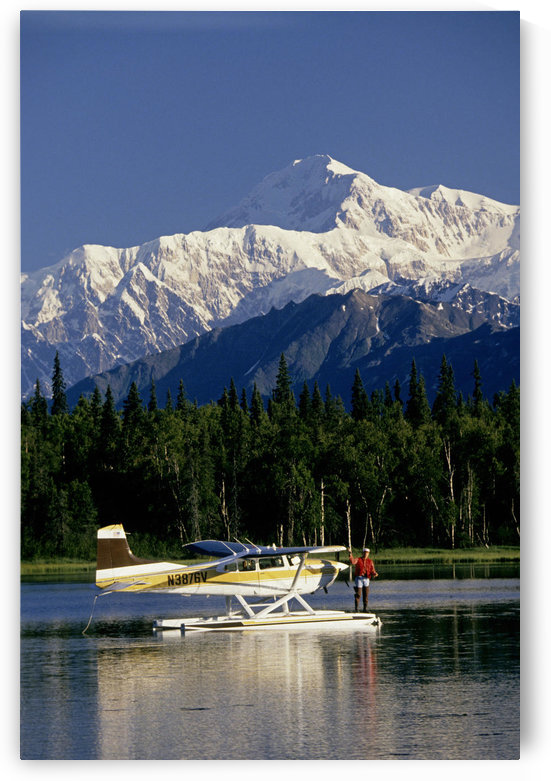 Man Spin Fishing On Lake From Floatplane With Southside Mt. Mckinley And Alaska Range In The Background,Southcentral Alaska, Summer by PacificStock