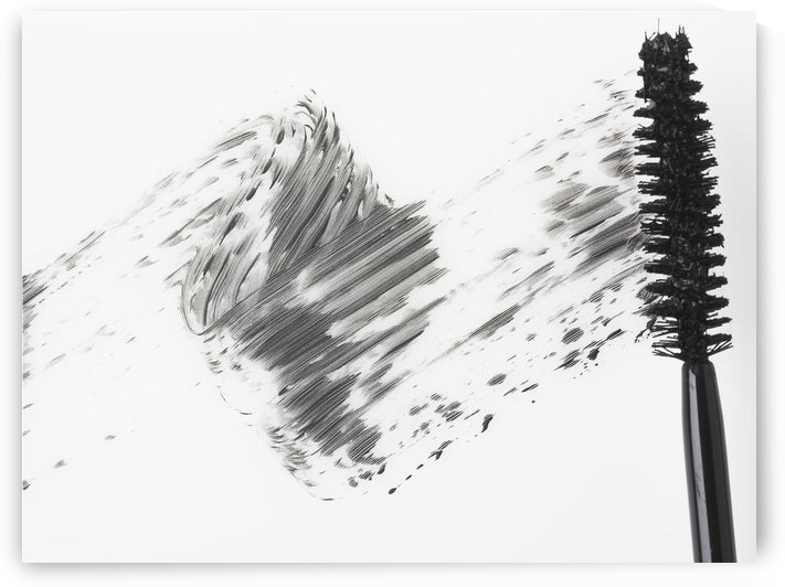 Mascara brush leaving traces of mascara on a white background by PacificStock
