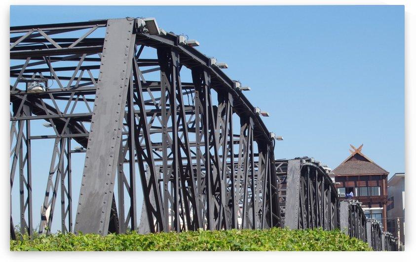 Metal girder arched bridge spans. by Alan Skau