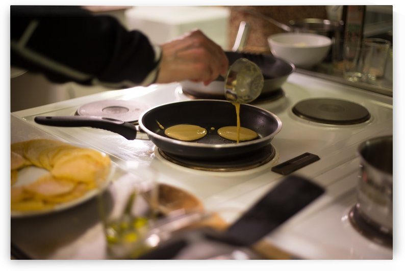 Cooking pancakes in kitchen by Danial Daoud