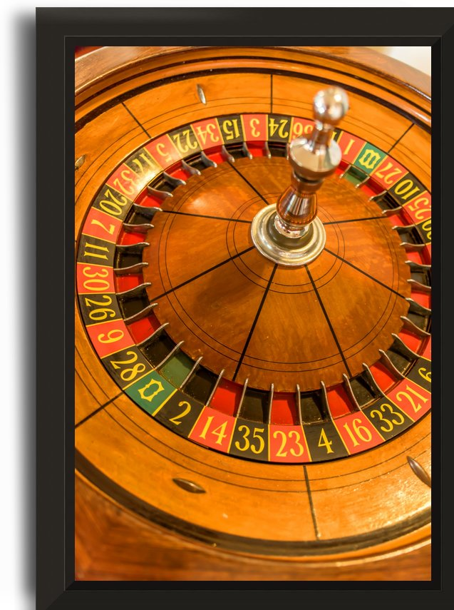 Round, wooden roulette wheel with numbers around the wheel by Viktor Birkus