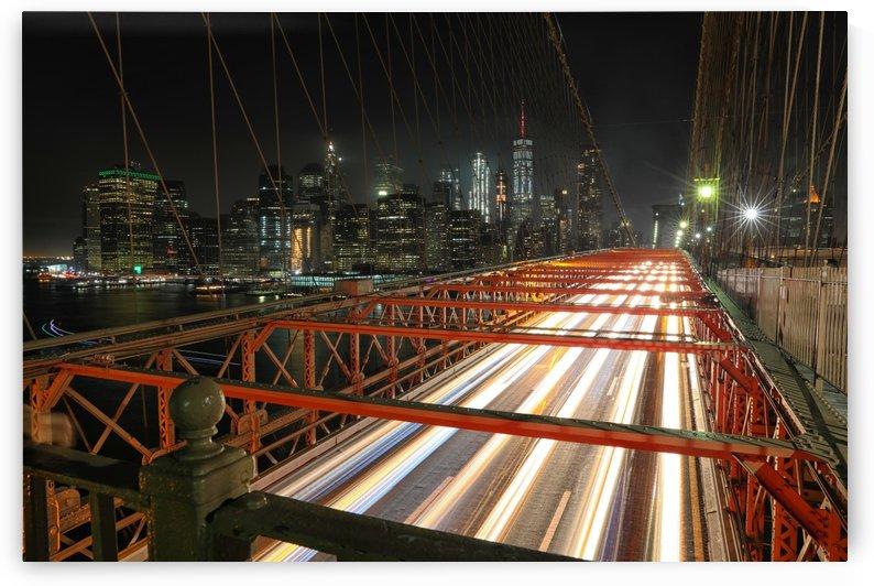 Traffic at NIght on the Brooklyn Bridge by Kaye