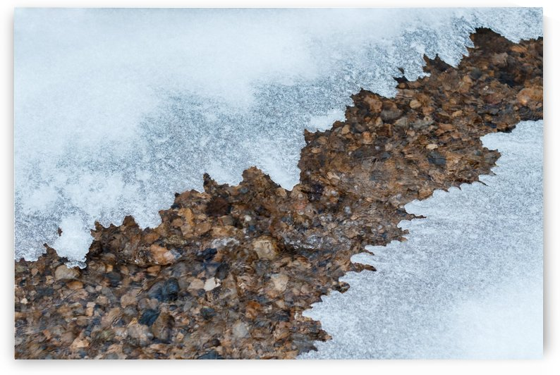 thin plate of ice covering a small mountain stream by Besa Art