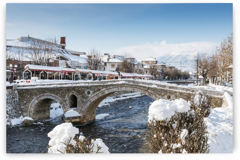 paving stones bridge and bistrica river of prizren Kosovo at winter season by Besa Art
