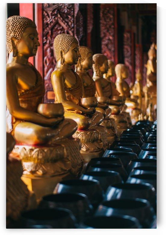 Golden buddha statues by Krit of Studio OMG