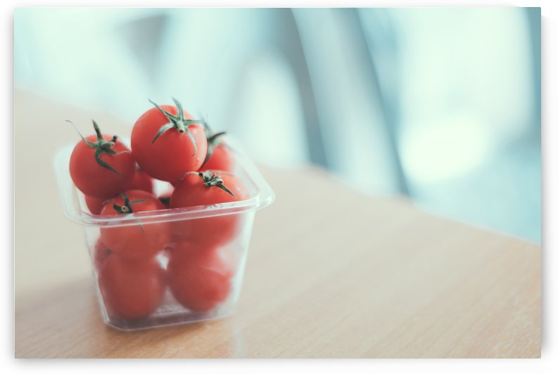 Red tomatoes in container by Krit of Studio OMG