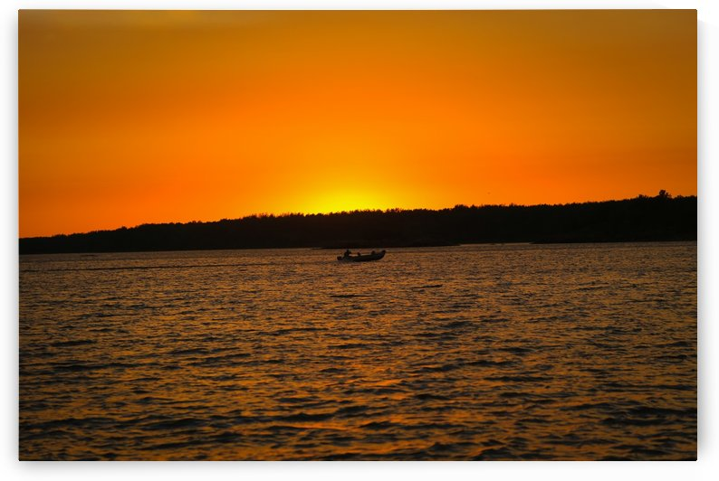 SUNSET AND BOAT BY THE WATER by Michael