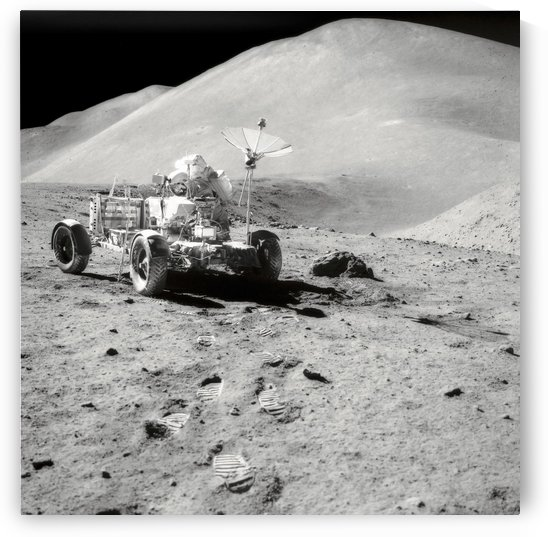 Apollo 15 astronaut works at the Lunar Roving Vehicle on the moons surface. by StocktrekImages