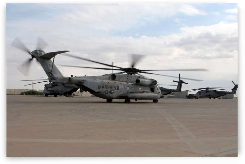 A CH-53E Super Stallion helicopter taxies down the flight line. by StocktrekImages