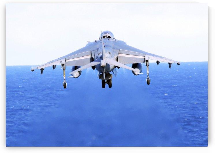 An AV-8B Harrier jet launches off the flight deck of USS Peleliu. by StocktrekImages