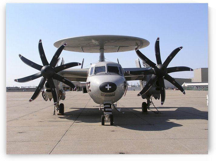 An E-2C+ Hawkeye sits on the flight line on board Naval Station Norfolk Virginia. by StocktrekImages