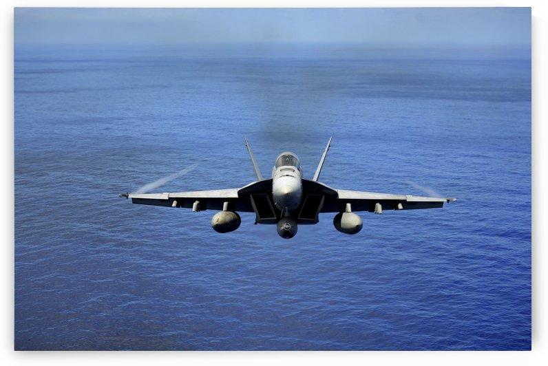 An F-A-18E Super Hornet over the Pacific Ocean. by StocktrekImages
