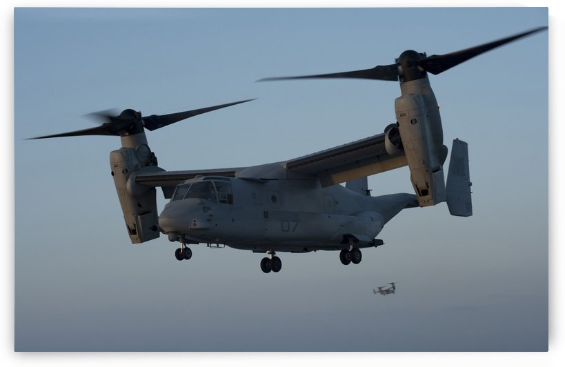 An MV-22 Osprey prepares to land on the flight deck of USS Anchorage. by StocktrekImages