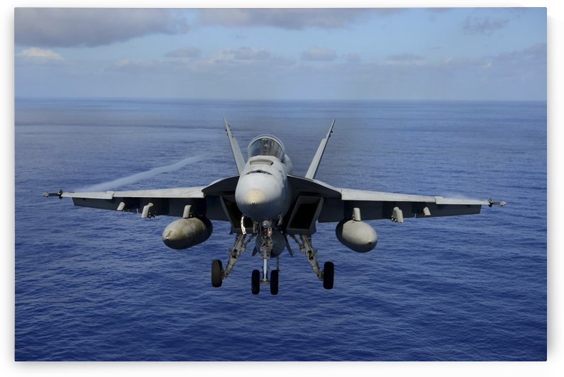 An F-A-18E Super Hornet over the Pacific Ocean. by StocktrekImages