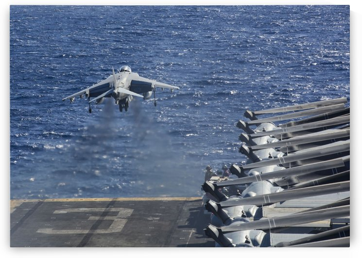 An AV-8B Harrier takes off from the flight deck of the USS Kearsarge. by StocktrekImages