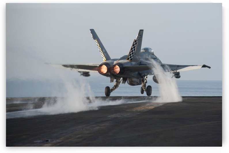 An F-A-18C Hornet launches from USS Harry S. Truman. by StocktrekImages