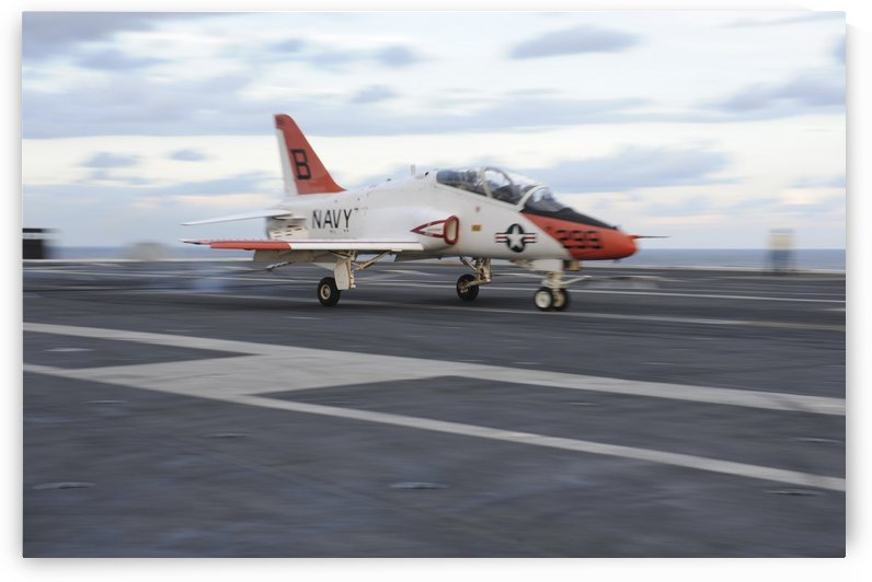A T-45C Goshawk is launched from the flight deck of USS Theodore Roosevelt. by StocktrekImages