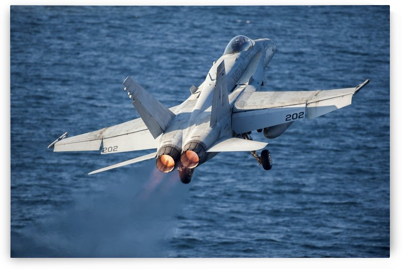 An F-A-18C Hornet launches from the flight deck of USS Harry S. Truman. by StocktrekImages