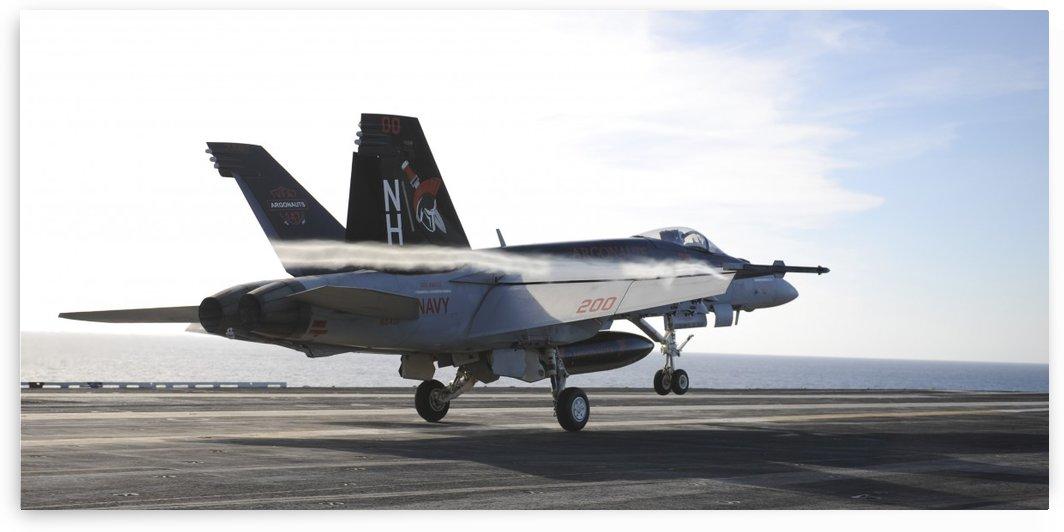 An F-A-18E Super Hornet touches the flight deck of USS Nimitz. by StocktrekImages