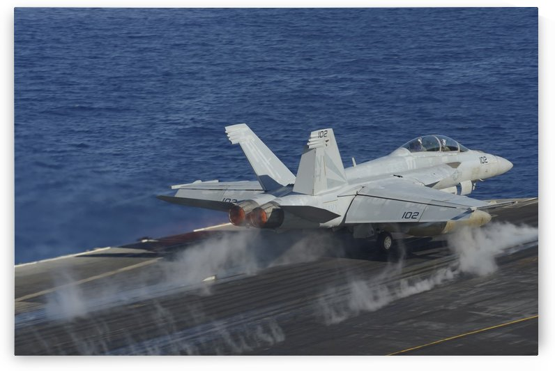 An F-A-18F Super Hornet launches from the flight deck of USS Nimitz. by StocktrekImages