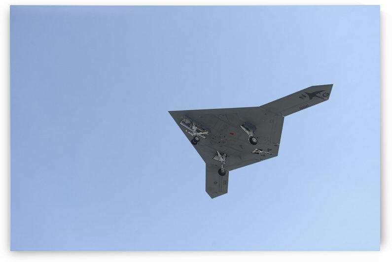 An X-47B unmanned combat air system in flight. by StocktrekImages