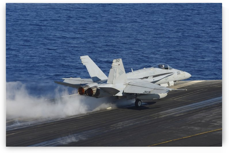 An F-A-18F Hornet launches from the flight deck of USS Nimitz. by StocktrekImages