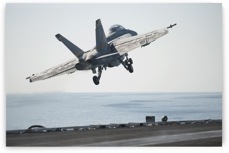 An F-A-18F Super Hornet launches from the flight deck of USS Harry S. Truman. by StocktrekImages