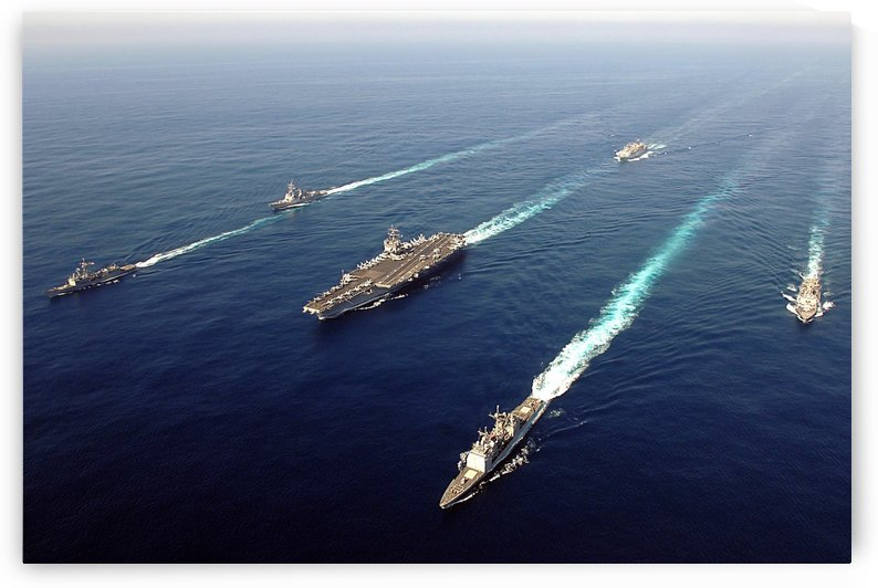The Enterprise Carrier Strike group sails through the Atlantic Ocean in formation. by StocktrekImages