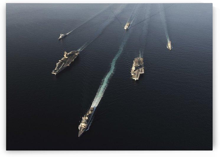 Fleet of Navy ships transit the Arabian Sea. by StocktrekImages