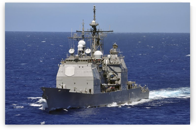 The guided-missile cruiser USS Chancellorsville transits the Pacific Ocean. by StocktrekImages