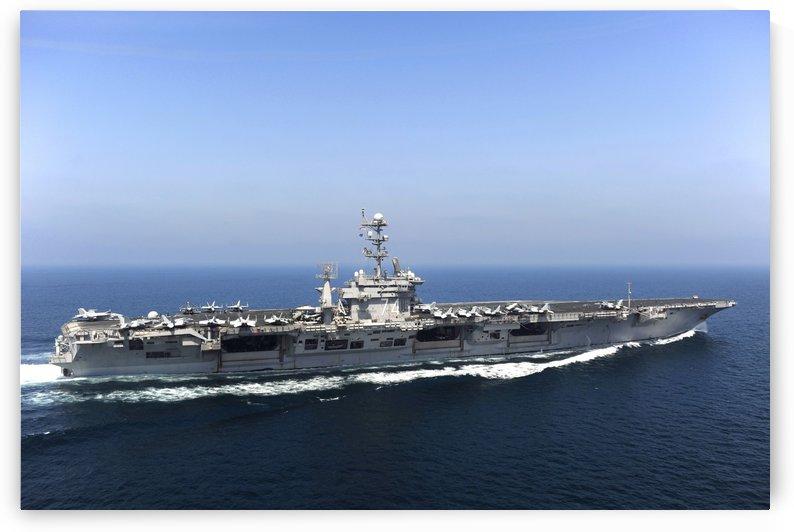 Aircraft carrier USS John C. Stennis transits the Arabian Gulf. by StocktrekImages