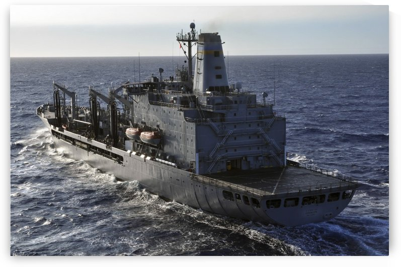 The Military Sealift Command fleet replenishment oiler USNS Guadalupe transits the Pacific Ocean. by StocktrekImages