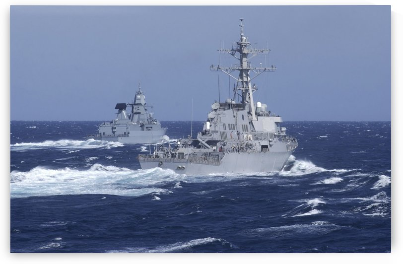 USS Carney practices diversion tactics with the German frigate Sachsen. by StocktrekImages