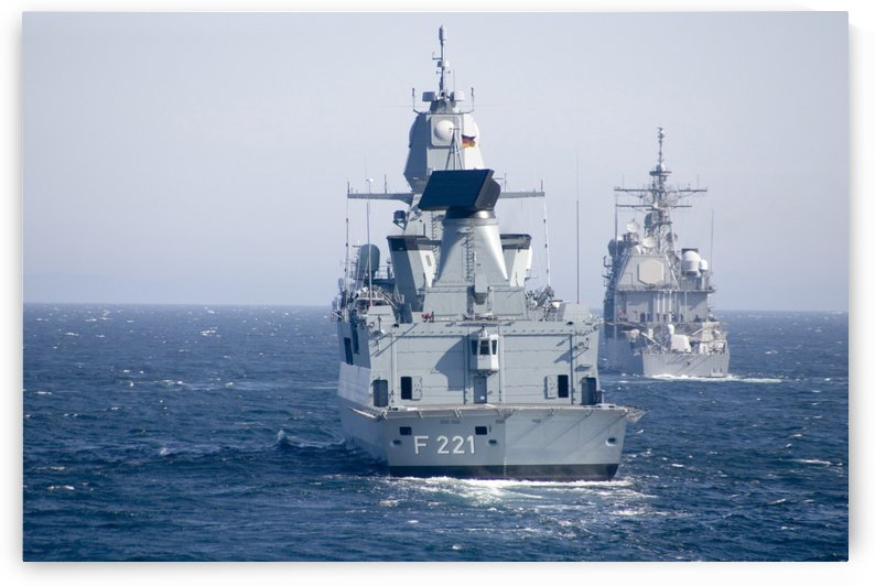 German frigate FFG Hessen and USS Normandy off the coast of Scotland. by StocktrekImages
