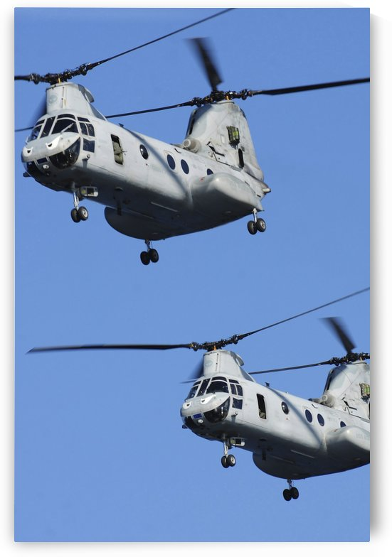 Two U.S. Marine Corps CH-46E Sea Knight helicopters in flight. by StocktrekImages