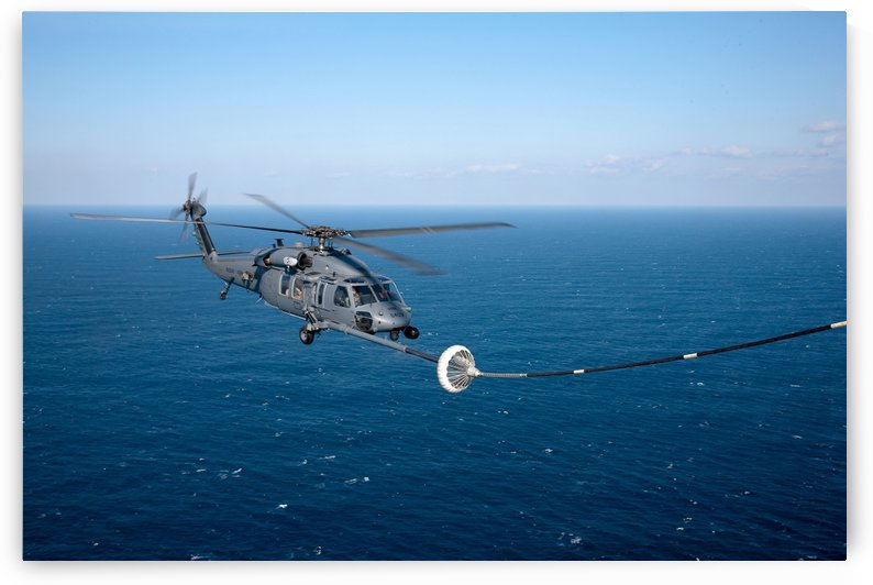 An HH-60 Pave Hawk refuels over the Pacific Ocean. by StocktrekImages