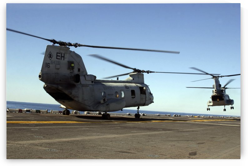 CH-46E Sea Knight helicopters practice vertical replenishments aboard USS Bataan. by StocktrekImages
