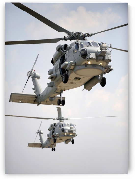 Two multi-mission MH-60R Sea Hawk helicopters fly in tandem. by StocktrekImages