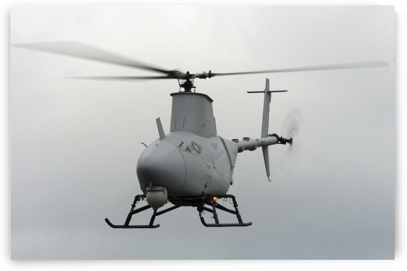 A RQ-8A Fire Scout unmanned aerial vehicle in flight. by StocktrekImages