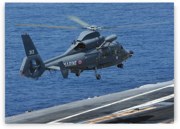 A French Dolphin 35F helicopter takes off from the flight deck of USS John C. Stennis. by StocktrekImages